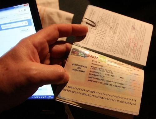Russisch visum in paspoort en migratiekaartje